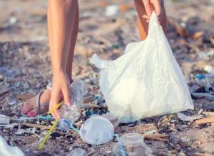 Plastic straws and plastic litter on beach